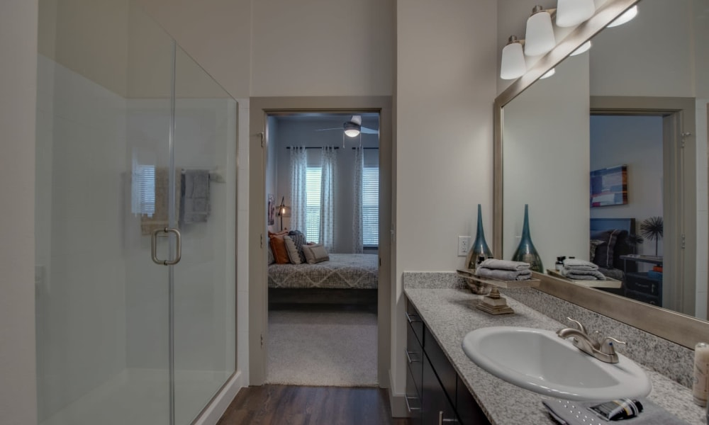Bathroom with huge mirror at Bellrock Upper North in Haltom City, Texas