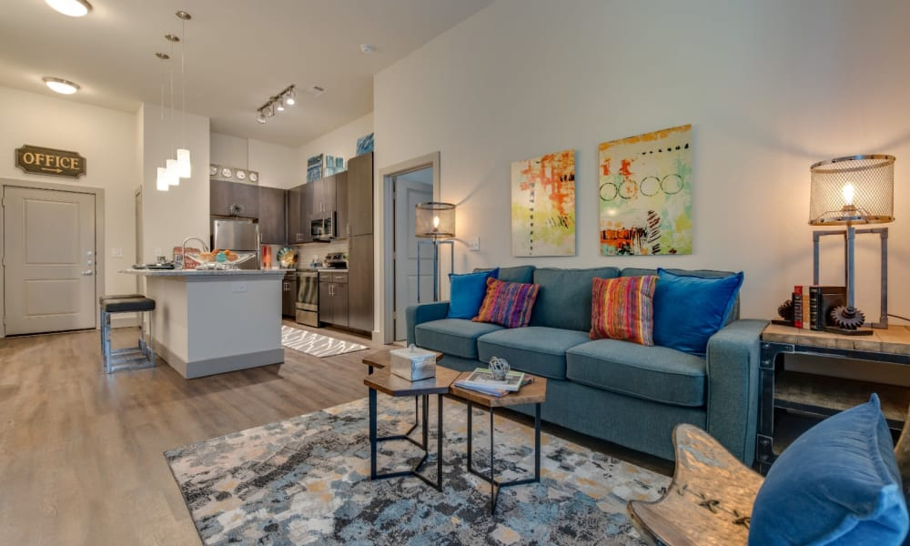 Spacious living room in model home with cute rug at Bellrock Upper North in Haltom City, Texas