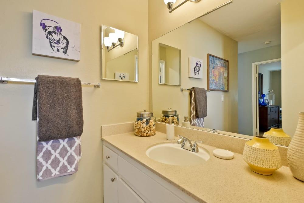 En suite master bathroom with a large vanity mirror in a model home at Sofi at Los Gatos Creek in San Jose, California