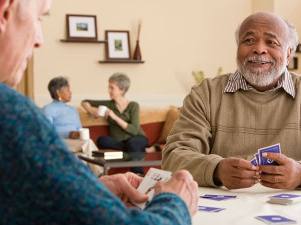 Careage residents playing cards.