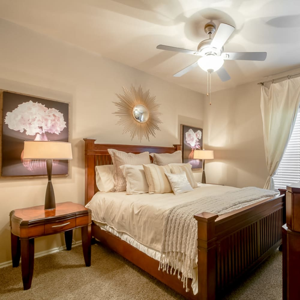 Large bedroom with ceiling fan and plush carpeting at Alon at Castle Hills in San Antonio, Texas