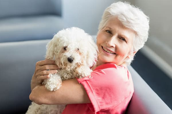 Woman with a dog at Reunion Court of The Woodlands in The Woodlands, Texas