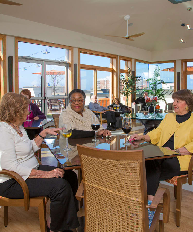 Residents enjoying a glass of wine together in of our restaurant-style dining rooms at All Seasons Oro Valley in Oro Valley, Arizona
