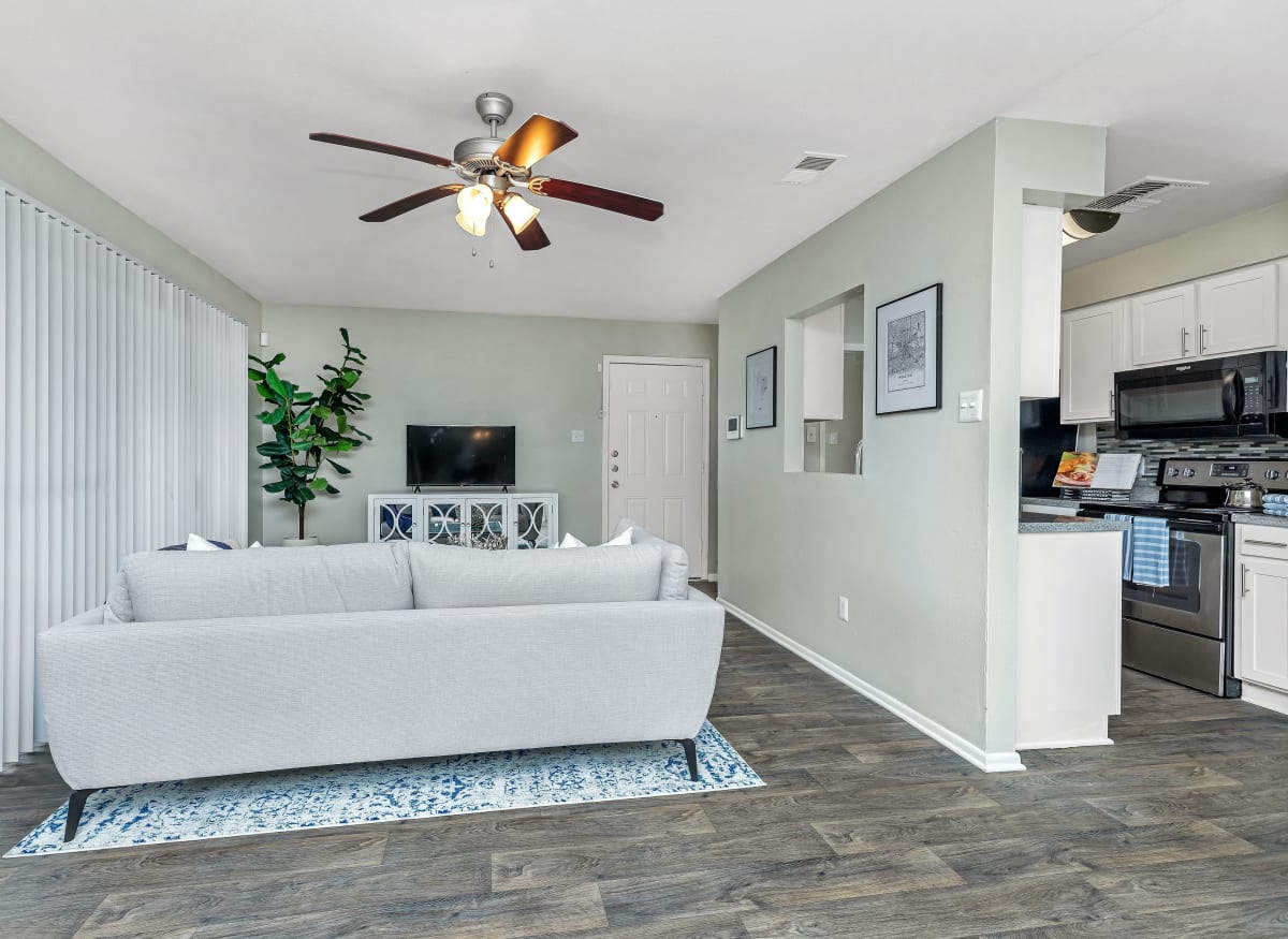 Spacious living room with a ceiling fan at Barringer Square in Webster, Texas