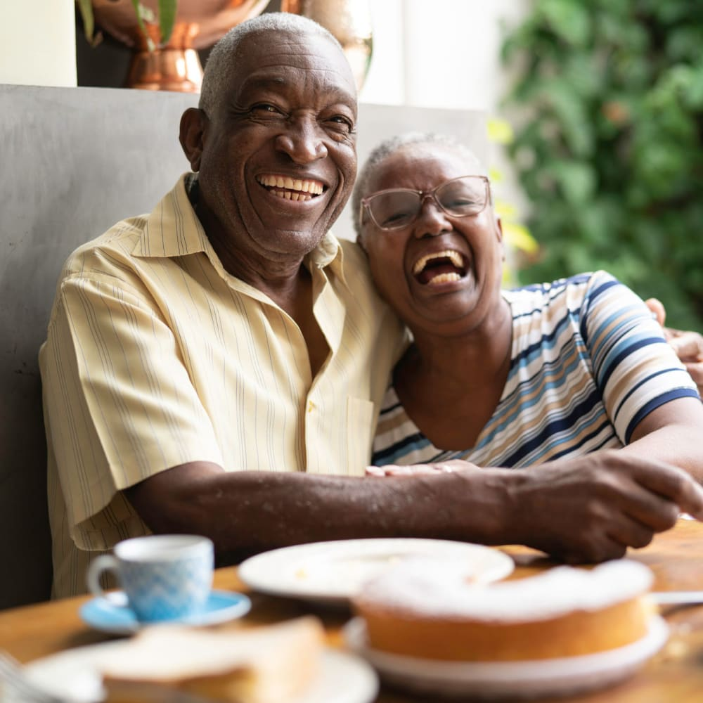 Resident couple hugging and laughing at Governor's Village in Mayfield Village, Ohio