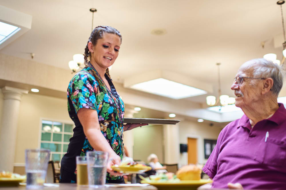 Resident getting lunch at Arbors Memory Care in Sparks, Nevada