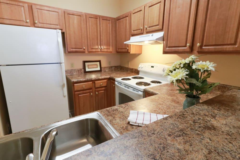 Kitchen, refrigerator, wood cabinets