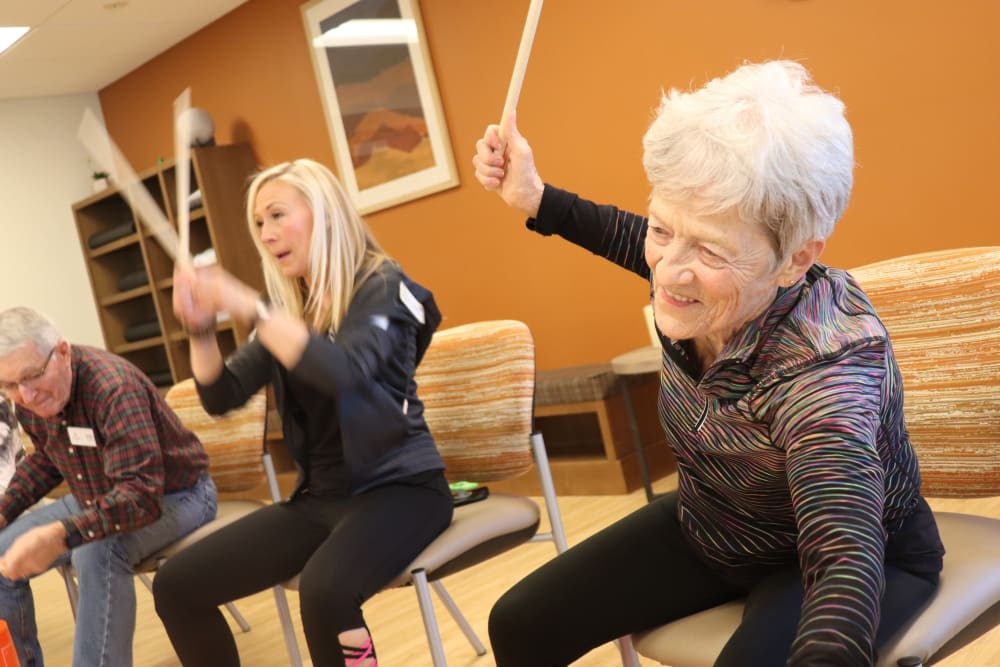 Resident and caregiver doing drumming exercise at The Springs at Bozeman in Bozeman, Montana