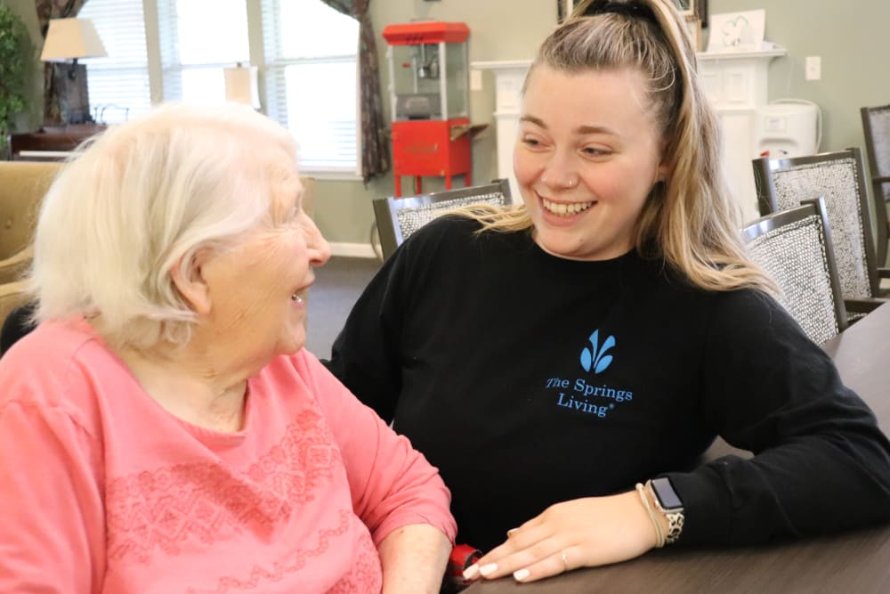 Resident chatting with caregiver at The Springs at Clackamas Woods in Milwaukie, Oregon.
