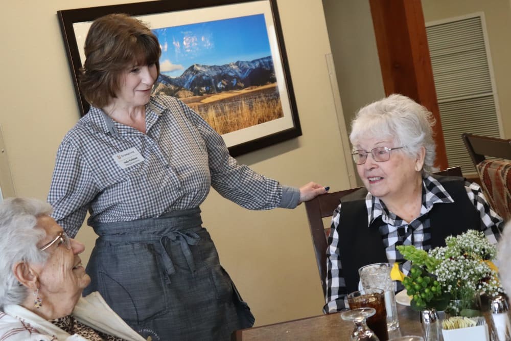 Two residents and a caregiver about to enjoy a meal at The Springs at Butte in Butte, Montana