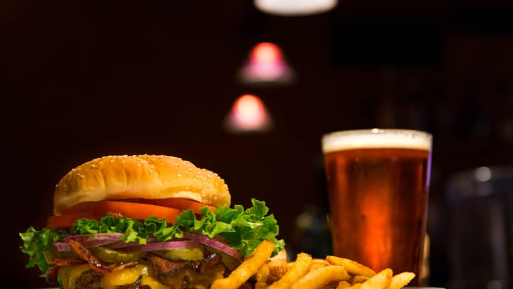 Burger and beer at a restaurant near Elevation Chandler in Chandler, Arizona