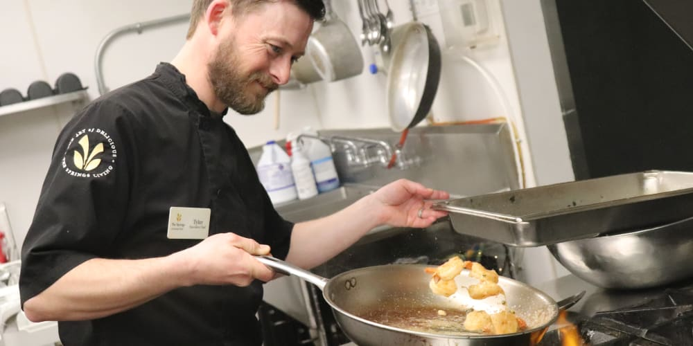 Chef preparing delicious meal at The Springs at Grand Park in Billings, Montana