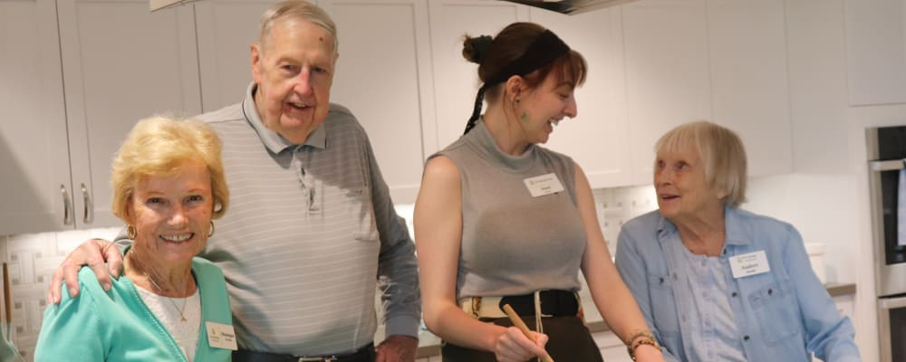 Residents engaged in a cooking event at The Springs at Sherwood in Sherwood, Oregon