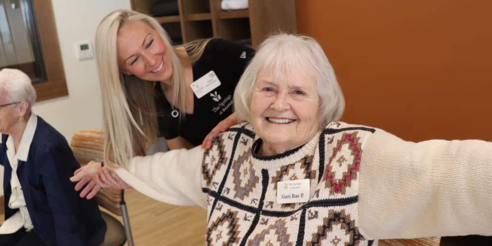 Smiling senior resident and caregiver at The Springs at Bozeman in Bozeman, Montana