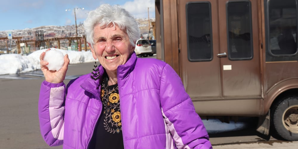 Resident enjoying winter fun at The Springs at Butte in Butte, Montana