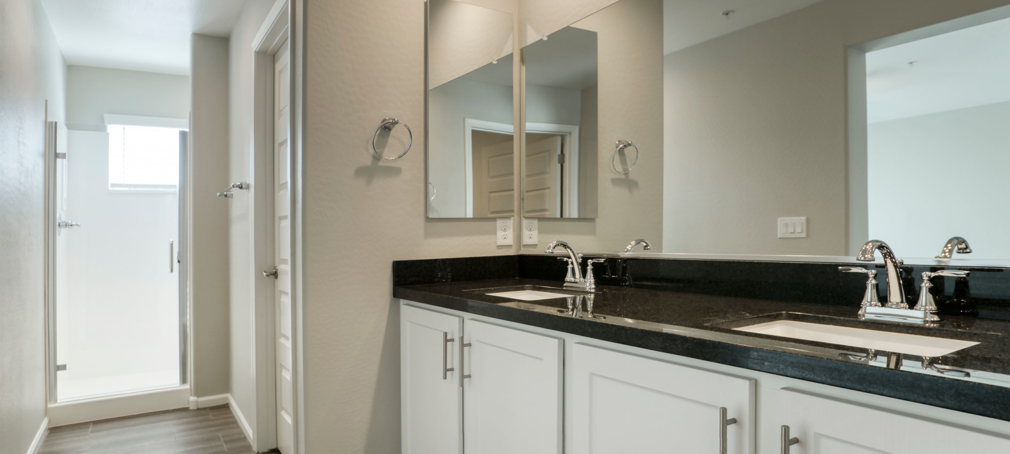 Spacious bathroom with white cabinets at BB Living at Eastmark in Mesa, Arizona