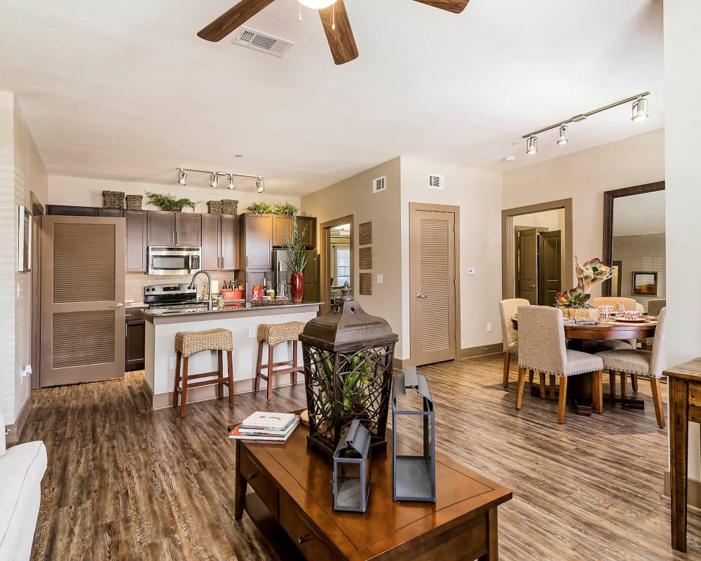 Beautiful hardwood floors and a ceiling fan in the living areas of a model home at Sedona Ranch in Odessa, Texas