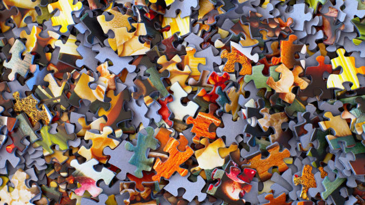 pile of puzzle piece lying on a table