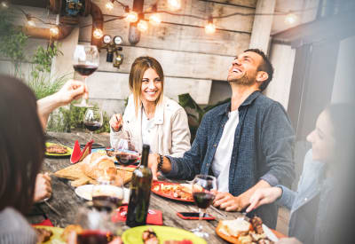 Residents friends enjoying a meal near Coach House Apartments in Kansas City, Missouri