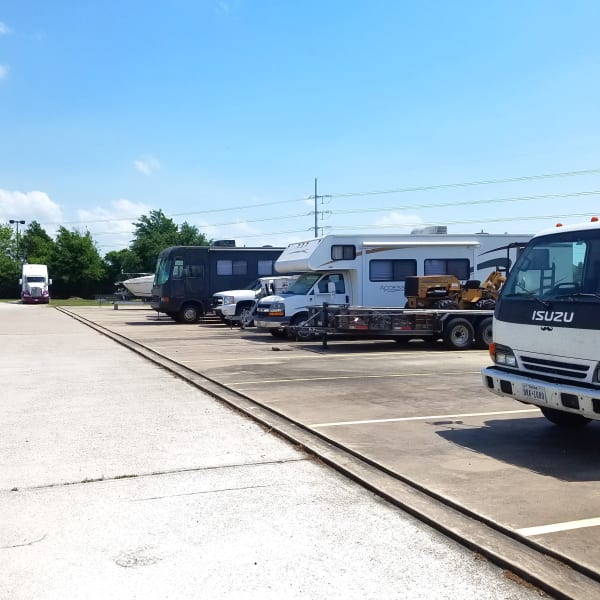 Outdoor parking spaces for RVs, trucks, and trailers at StorQuest Self Storage in Spring, Texas