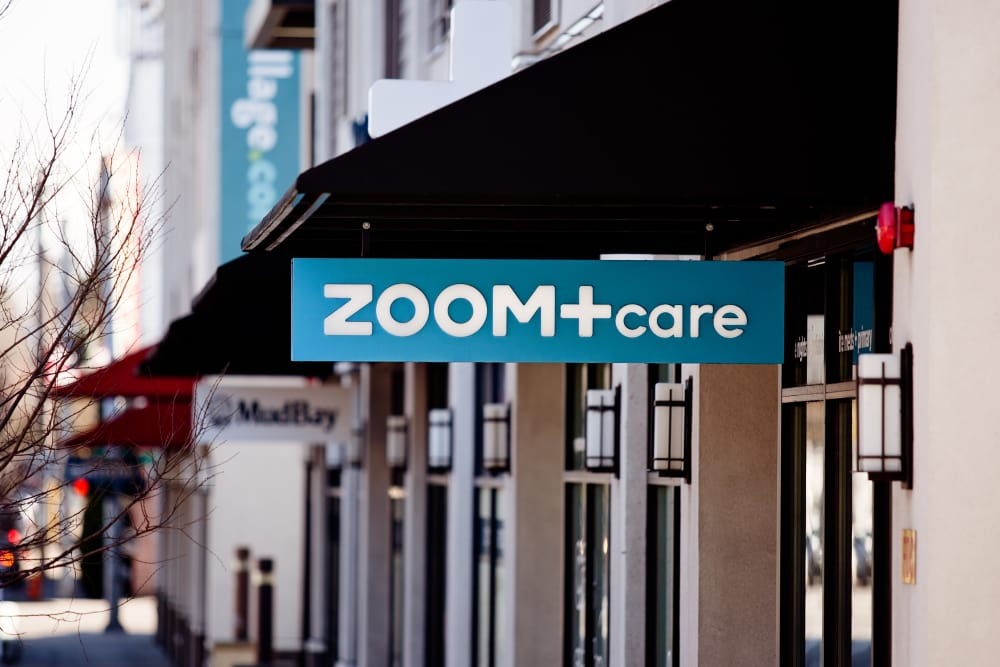 ZOOM+care sign outside their shop near Grant Park Village