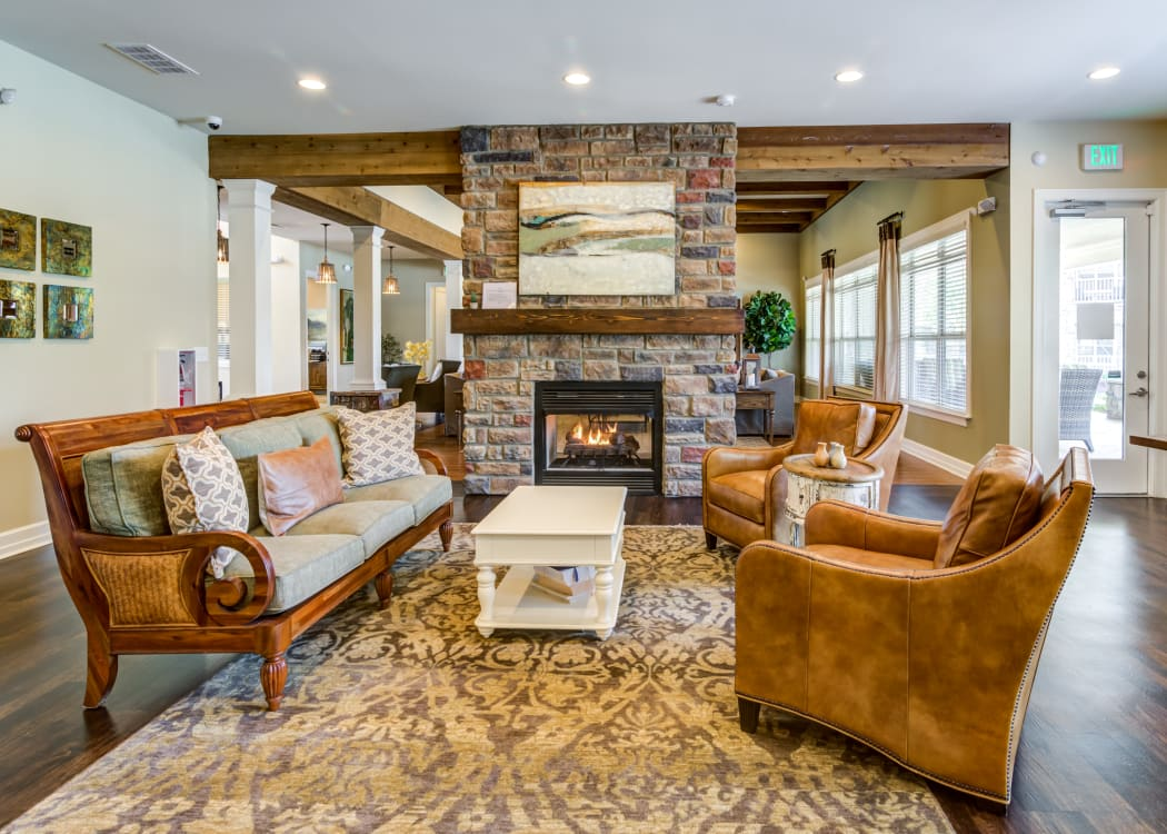 Clubhouse seating area with fireplace for residents at Commonwealth at 31 in Spring Hill, Tennessee