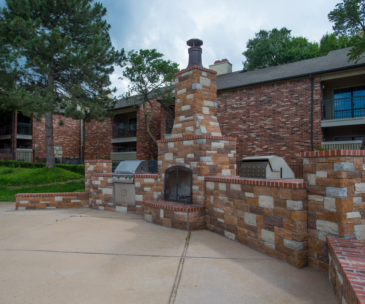 Outdoor fireplace and grill at Warrington Apartments in Oklahoma City, Oklahoma