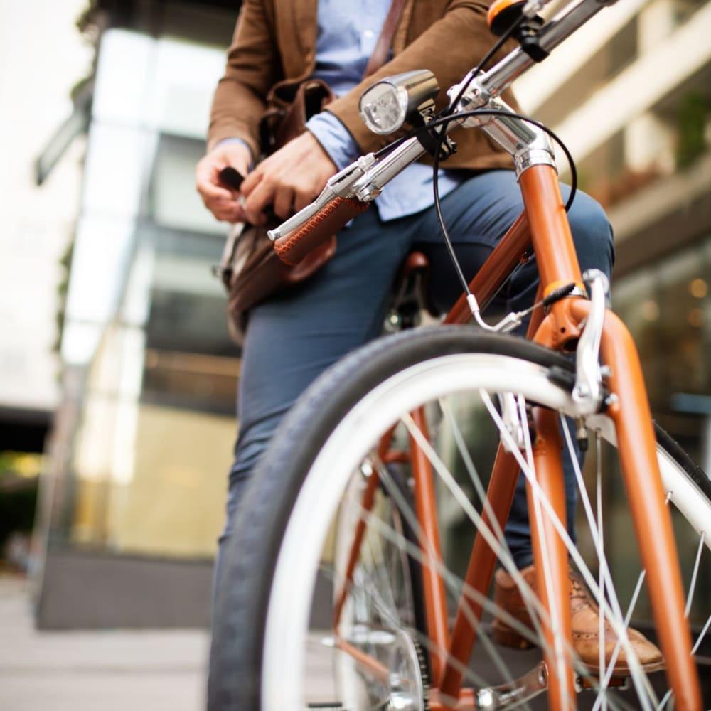 Resident taking his bike for a ride around the neighborhood near Riverside Manor in Fredericksburg, Virginia