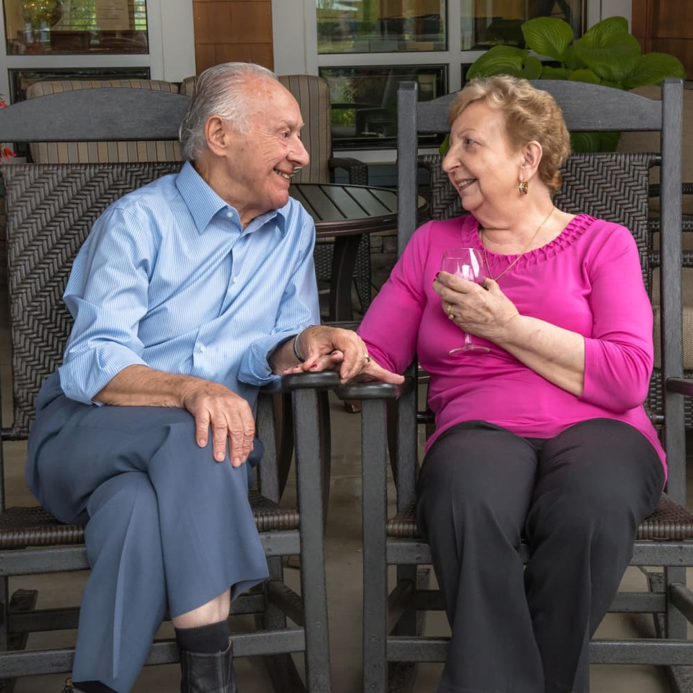 Two residents chatting on patio at The Springs at Veranda Park in Medford, Oregon
