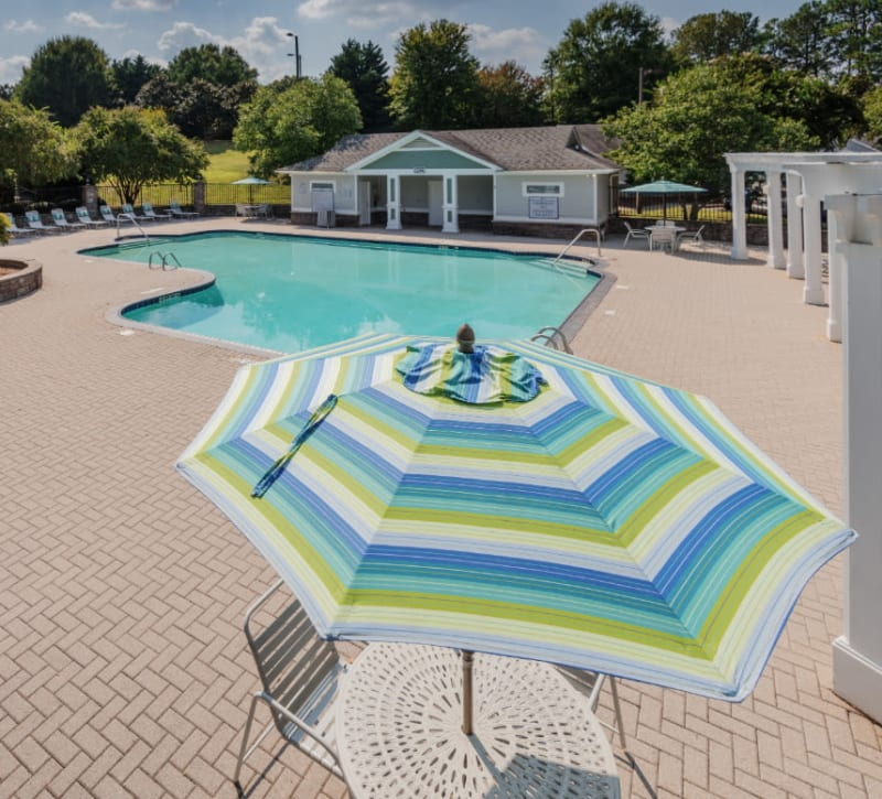 A swimming pool wiht an expansive sundeck at Residences at West Mint in Mint Hill, North Carolina