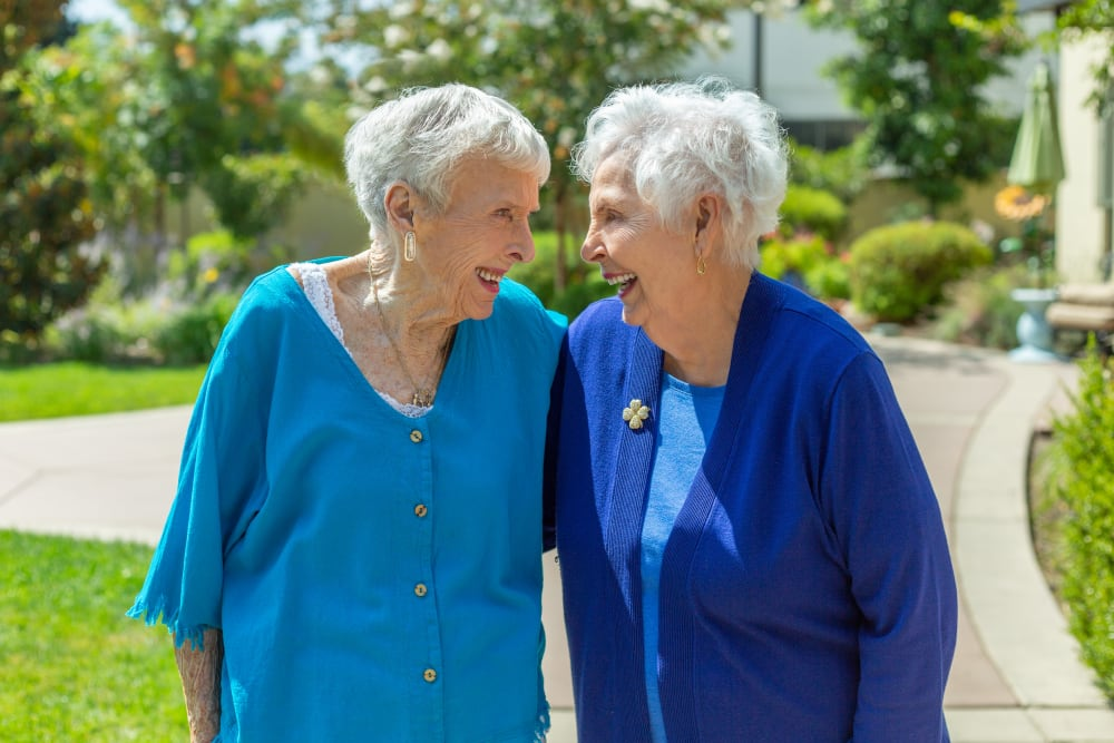 Two ladies enjoying the sunshine at Merrill Gardens at Rolling Hills Estates in Rolling Hills Estates, California
