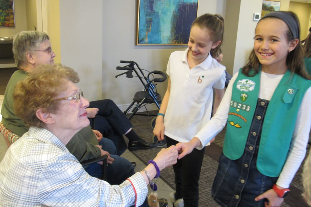 senior residents talking with young children