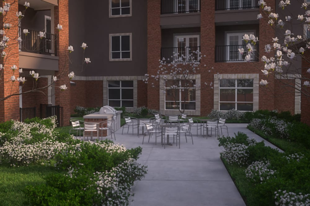 Outdoor seating in the courtyard at Harmony at Oakbrooke in Chesapeake, Virginia