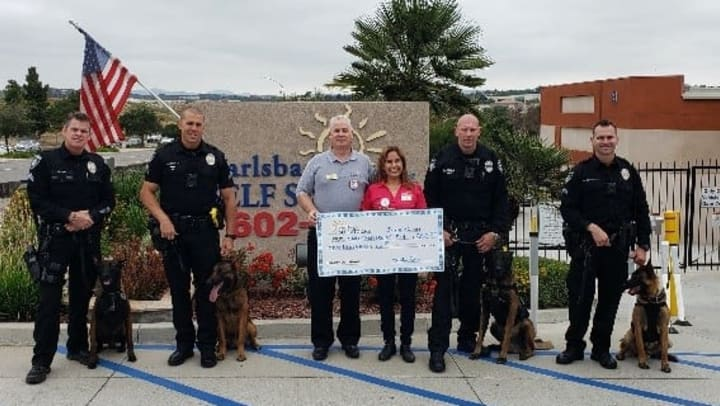 Carlsbad Self Storage presenting check to the Carlsbad Police Department