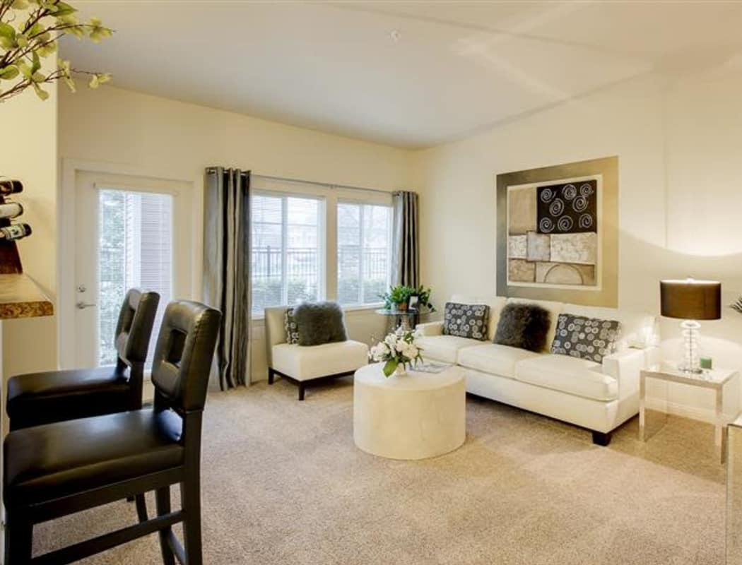 Spacious and bright living room in model home at Woodland Apartments in Olympia, Washington