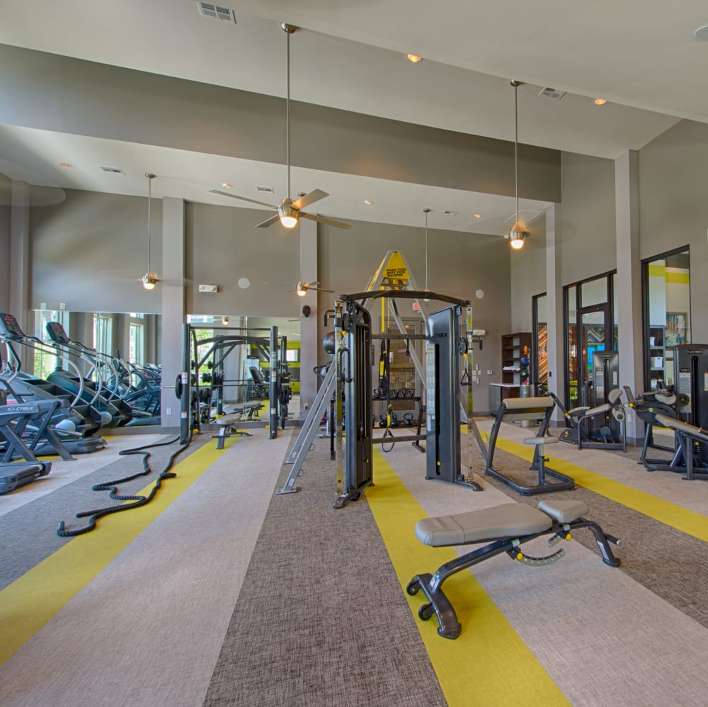Fitness center with individual workout stations at Elite 99 West in Katy, Texas
