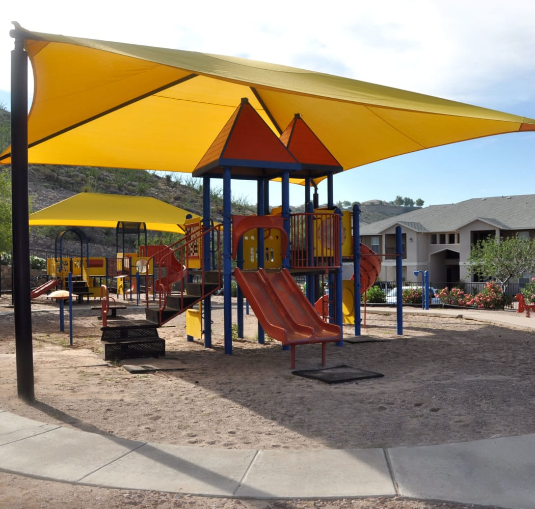 Covered playground at Acacia Park Apartments in El Paso, Texas