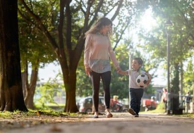 Resident mom walking her son to school near Dulles Greene in Herndon, Virginia