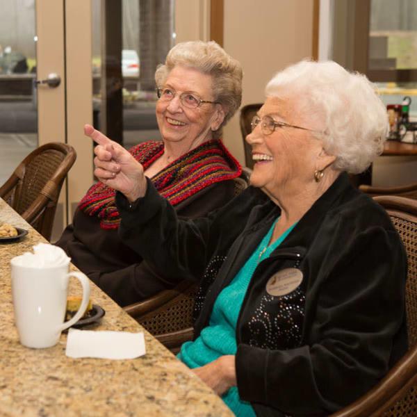 Two residents ordering food at Quail Park at Browns Point in Tacoma, Washington