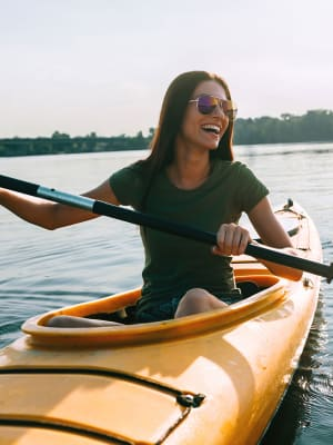A woman enjoys getting out on the water in her kayak near M2 Apartments in Denver, Colorado