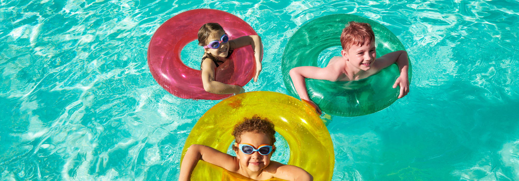 Kids playing in the pool at Las Casas at Windrose in Litchfield Park, Arizona
