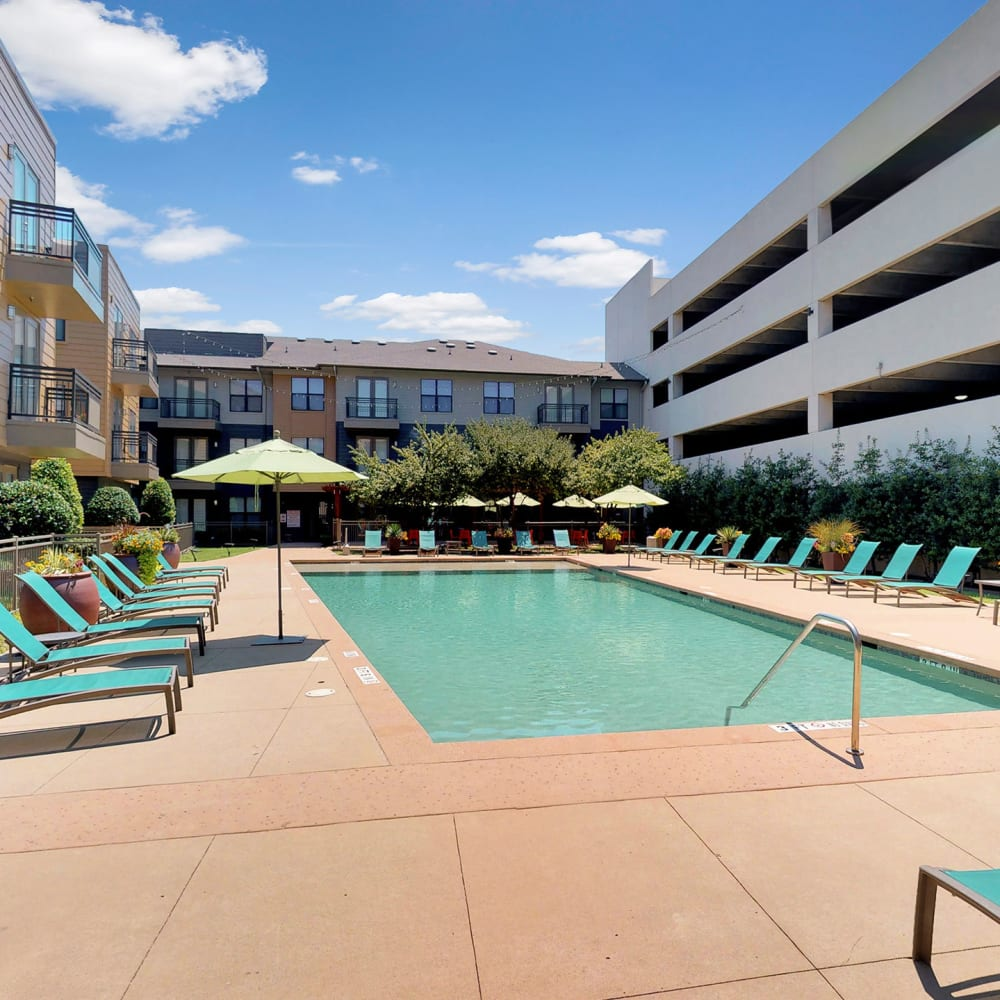 Serene swimming pool on a beautiful afternoon at Oaks 5th Street Crossing at City Station in Garland, Texas