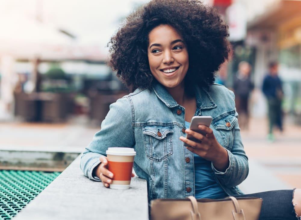 A woman takes a coffee break near Kestrel Park in Vancouver, Washington
