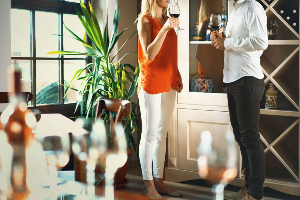 Residents enjoying some fine wine in their keyless electronic entry home at Sentio in Phoenix, Arizona