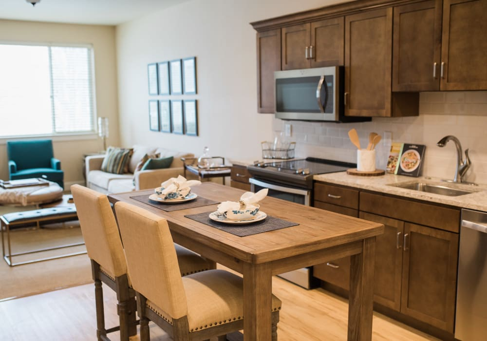 A kitchen and living room in an apartment at Touchmark on South Hill in Spokane, Washington