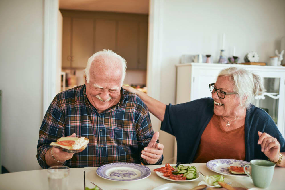 Resident couple enjoying a meal at Alura By Inspired Living in Rockledge, Florida.