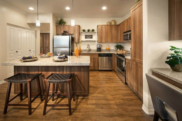 Spacious kitchen with breakfast bar at San Hacienda in Chandler, Arizona