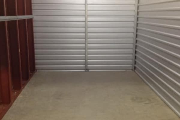 A spacious and clean storage unit at One Stop Storage.