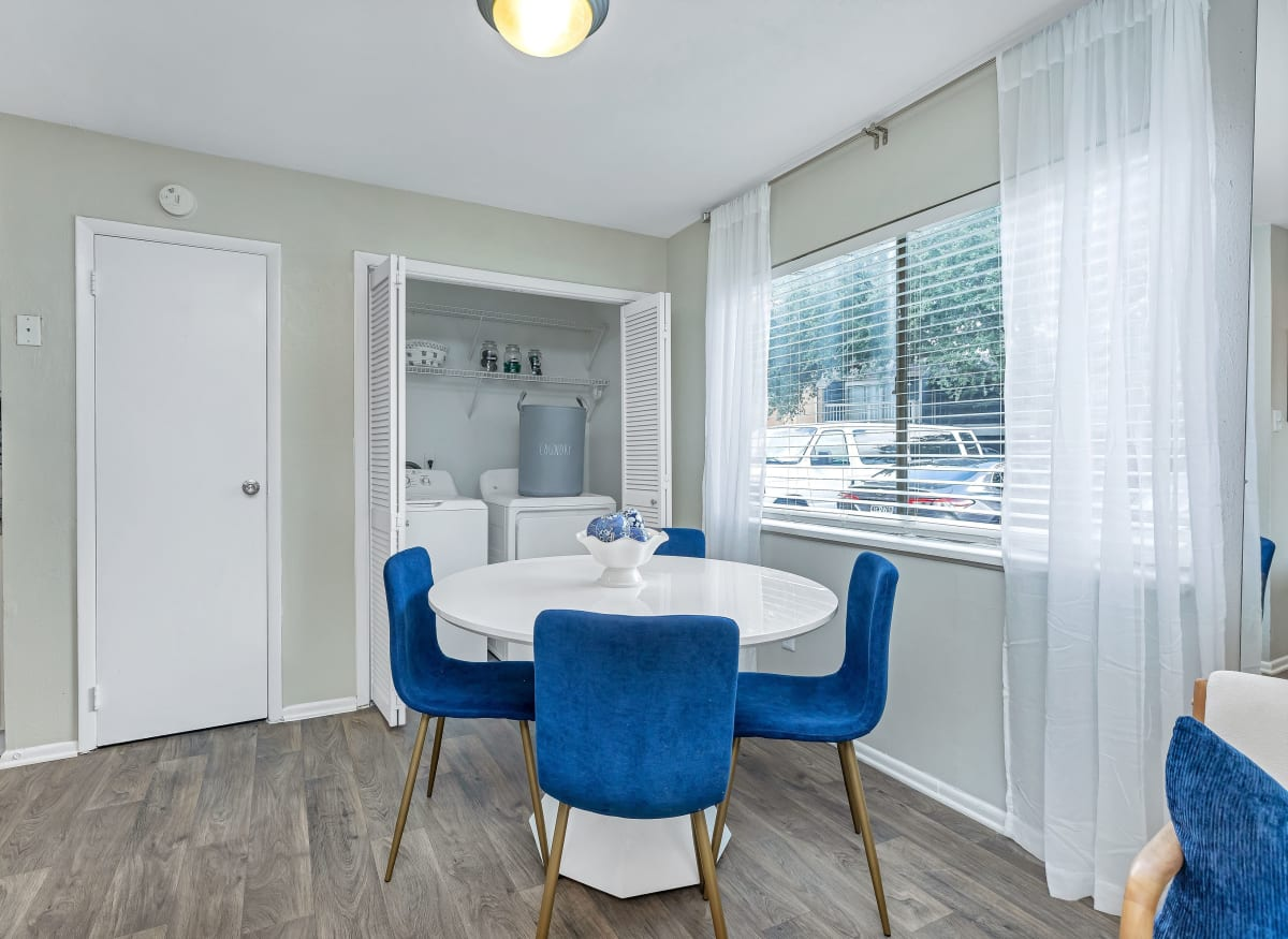 A spacious dining room with a large window at Barringer Square in Webster, Texas
