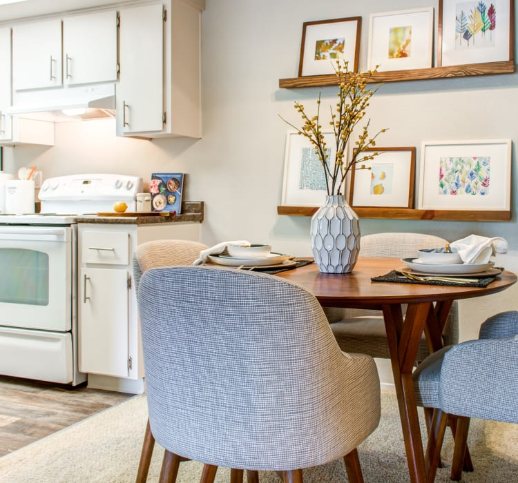 Well-furnished dining area near the kitchen of a model home at Sofi Dublin in Dublin, California